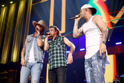 (EDITORIAL USE ONLY. NO COMMERCIAL USE) Morgan Wallen (C) performs with Brian Kelley (L) and Tyler Hubbard (R) of Florida Georgia Line onstage during the 2019 iHeartCountry Festival Presented by Capital One at the Frank Erwin Center on May 4, 2019 in Austin, Texas.