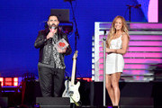 Enrique Santos and Jennifer Lopez speaks onstage at the 2019 iHeartRadio Fiesta Latina at AmericanAirlines Arena on November 2, 2019 in Miami, Florida.