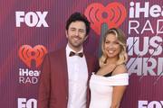 (L-R) Beau Clark and Stassi Schroeder attend the 2019 iHeartRadio Music Awards which broadcasted live on FOX at Microsoft Theater on March 14, 2019 in Los Angeles, California.