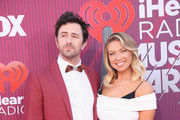 (EDITORIAL USE ONLY. NO COMMERCIAL USE) Beau Clark and Stassi Schroeder attend the 2019 iHeartRadio Music Awards which broadcasted live on FOX at Microsoft Theater on March 14, 2019 in Los Angeles, California.