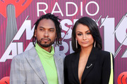 (EDITORIAL USE ONLY. NO COMMERCIAL USE) (L-R) Miguel and Nazanin Mandi attend the 2019 iHeartRadio Music Awards which broadcasted live on FOX at Microsoft Theater on March 14, 2019 in Los Angeles, California.