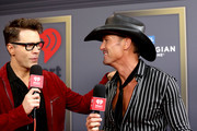 (EDITORIAL USE ONLY) (L-R) Bobby Bones and Tim McGraw attend the 2019 iHeartRadio Music Festival at T-Mobile Arena on September 20, 2019 in Las Vegas, Nevada.