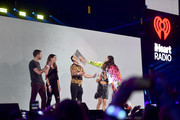 (EDITORIAL USE ONLY) Steve Aoki throws cake on guest during the 2019 iHeartRadio Music Festival at T-Mobile Arena on September 20, 2019 in Las Vegas, Nevada.