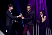 (EDITORIAL USE ONLY. NO COMMERCIAL USE) Bobby Bones (C) receives award onstage from Matt Johnson and Kim Schifino of Matt and Kim at the 2019 iHeartRadio Podcast Awards Presented by Capital One at the iHeartRadio Theater LA on January 18, 2019 in Burbank, California.