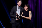(EDITORIAL USE ONLY. NO COMMERCIAL USE) (L-R) Matt Johnson and Kim Schifino of Matt and Kim presents onstage at the 2019 iHeartRadio Podcast Awards Presented by Capital One at the iHeartRadio Theater LA on January 18, 2019 in Burbank, California.