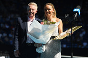 Caroline Wozniacki and Craig Tilley pose during the women's day ceremony on Rod Laver Arena on day eleven of the 2020 Australian Open at Melbourne Park on January 30, 2020 in Melbourne, Australia.