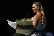 Caroline Wozniacki is presented with flowers during the women's day ceremony on Rod Laver Arena on day eleven of the 2020 Australian Open at Melbourne Park on January 30, 2020 in Melbourne, Australia.