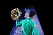 Novak Djokovic of Serbia walks a lap of honour with the Norman Brookes Challenge Cup after winning the Men's Singles Final against Dominic Thiem of Austria on day fourteen of the 2020 Australian Open at Melbourne Park on February 02, 2020 in Melbourne, Australia.
