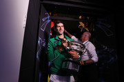 Novak Djokovic of Serbia walks off Margaret Court Arena holding the Norman Brookes Challenge Cup after winning the Men's Singles Final against Dominic Thiem of Austria on day fourteen of the 2020 Australian Open at Melbourne Park on February 02, 2020 in Melbourne, Australia.