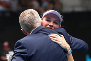 Caroline Wozniacki of Denmark embraces her family after her Women's Singles third round match against Ons Jabeur of Tunisia day five of the 2020 Australian Open at Melbourne Park on January 24, 2020 in Melbourne, Australia.