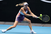 Caroline Wozniacki of Denmark plays a backhand during her Women's Singles third round match against Ons Jabeur of Tunisia on day five of the 2020 Australian Open at Melbourne Park on January 24, 2020 in Melbourne, Australia.