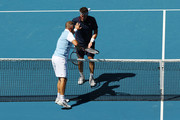 Pat Cash of Australia interacts with Thomas Muster of Austria during their Men's Legends Doubles match on day eight of the 2020 Australian Open at Melbourne Park on January 27, 2020 in Melbourne, Australia.