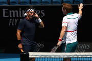 Pat Cash (L) and Mark Woodforde of Australia react in their Men's Legends Doubles match against Thomas Muster of Austria and Mats Wilander of Sweden on day eight of the 2020 Australian Open at Melbourne Park on January 27, 2020 in Melbourne, Australia.