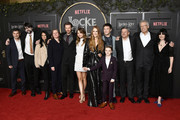 "(L-R) Michael Morris, Joe Hill, VP of Content Acquisition at Netflix Bela Bajaria, VP of Original Series at Netflix Cindy Holland, Bill Heck, Emilia Jones, Darby Stanchfield, Connor Jessup, Jackson Robert Scott, Netflix CCO Ted Sarandos, Carlton Cuse, and Meredith Averill attend Netflix's ""Locke & Key"" series premiere photo call at the Egyptian Theatre on February 05, 2020 in Hollywood, California."