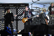 Retransmission with alternate crop.) (L-R) Robin Zander, Rick Nielsen, Tom Petersson and Daxx Nielsen of music group Cheap Trick performs on stage MusiCares Person of the Year honoring Aerosmith at West Hall at Los Angeles Convention Center on January 24, 2020 in Los Angeles, California.
