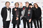(L-R) Daxx Nielsen, Tom Petersson, Rick Nielsen, Robin Zander, and Robin Taylor Zander Jr. of music group Cheap Trick attend MusiCares Person of the Year honoring Aerosmith at West Hall at Los Angeles Convention Center on January 24, 2020 in Los Angeles, California.