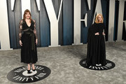 Bryce Dallas Howard (L) and Patricia Clarkson attend the 2020 Vanity Fair Oscar Party hosted by Radhika Jones at Wallis Annenberg Center for the Performing Arts on February 09, 2020 in Beverly Hills, California.