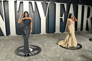 Kylie Jenner and Kim Kardashian attend the 2020 Vanity Fair Oscar Party hosted by Radhika Jones at Wallis Annenberg Center for the Performing Arts on February 09, 2020 in Beverly Hills, California.