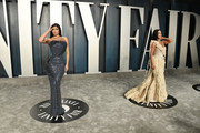 Kylie Jenner and Kim Kardashian (R) attend the 2020 Vanity Fair Oscar Party hosted by Radhika Jones at Wallis Annenberg Center for the Performing Arts on February 09, 2020 in Beverly Hills, California.