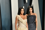Kim Kardashian and Kylie Jenner (R) attend the 2020 Vanity Fair Oscar Party hosted by Radhika Jones at Wallis Annenberg Center for the Performing Arts on February 09, 2020 in Beverly Hills, California.