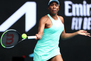 Venus Williams of The United States of America plays a forehand in her Women's Singles first round match against Kirsten Flipkens of Belgium during day one of the 2021 Australian Open at Melbourne Park on February 08, 2021 in Melbourne, Australia.