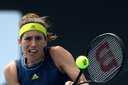 Andrea Petkovic of Germany plays a backhand in her Women's Singles first round match against Ons Jabeur of Tunisia during day one of the 2021 Australian Open at Melbourne Park on February 08, 2021 in Melbourne, Australia.