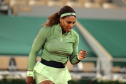 Serena Williams of The United States celebrates in their ladies singles first round match against Irina-Camelia Begu of Romania on day two of the 2021 French Open at Roland Garros on May 31, 2021 in Paris, France.