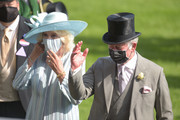 Prince Charles, Prince of Wales and Camilla, Duchess of Cornwall wave during Royal Ascot 2021 at Ascot Racecourse on June 15, 2021 in Ascot, England.