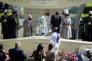 Prince Charles, Prince of Wales (L) and Camilla, Duchess of Cornwall (C) award jockey Kevin Manning (R) after he won the St James's Palace Stakes on Poetic Flare during Royal Ascot 2021 at Ascot Racecourse on June 15, 2021 in Ascot, England.
