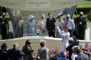 Prince Charles, Prince of Wales (L) and Camilla, Duchess of Cornwall (2ndL) award jockey Kevin Manning (R) after he won the St James's Palace Stakes on Poetic Flare during Royal Ascot 2021 at Ascot Racecourse on June 15, 2021 in Ascot, England.
