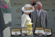 Prince Charles, Prince of Wales (R) and Camilla, Duchess of Cornwall (L) presenting the Prince Of Wales's Stakes during Royal Ascot 2021 at Ascot Racecourse on June 16, 2021 in Ascot, England.