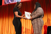 Lori Stokes presents an award to Gabourey Sidibe onstage during the 20th Anniversary Bottomless Closet Luncheon at Cipriani 42nd Street on May 15, 2019 in New York City.