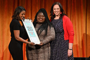 Lori Stokes (L) and Melissa Norden (R) present an award to Gabourey Sidibe (C) onstage during the 20th Anniversary Bottomless Closet Luncheon at Cipriani 42nd Street on May 15, 2019 in New York City.