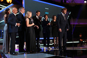 "Director Richard Linklater (C), producer Jonathan Sehring, actress Patricia Arquette, lawyer John Sloss, actor Ellar Coltrane and film editor Sandra Adair accept Best Picture award for ""Boyhood"" from actor Ben Kingsley (L) onstage during the 20th annual Critics' Choice Movie Awards at the Hollywood Palladium on January 15, 2015 in Los Angeles, California."