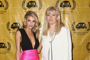 Charlotte McKinney and Monica Brady attend the 20th Annual Golden Trailer Awards at Theatre at the Ace Hotel on May 29, 2019 in Los Angeles, California.