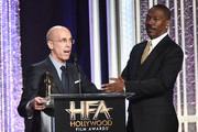 """Presenter Jeffrey Katzenberg (L) and actor Eddie Murphy, recipient of the """"Hollywood Career Achievement Award"""" speak onstage during the 20th Annual Hollywood Film Awards on November 6, 2016 in Beverly Hills, California."""