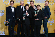 (L-R) Actors Ty Burrell, Ed O'Neill, Nolan Gould, Rico Rodriguez, Eric Stonestreet and Jesse Tyler Ferguson, winners of the Outstanding Performance by an Ensemble in a Comedy Series awards for 'Modern Family,' pose in the press room during the 20th Annual Screen Actors Guild Awards at The Shrine Auditorium on January 18, 2014 in Los Angeles, California.