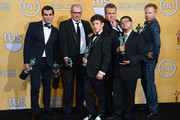(L-R) Actors Ty Burrell, Ed O'Neill, Nolan Gould, Eric Stonestreet, Rico Rodriguez, and Jesse Tyler Ferguson, winners of Outstanding Performance by an Ensemble in a Comedy Series for 'Modern Family,' pose in the press room during the 20th Annual Screen Actors Guild Awards at The Shrine Auditorium on January 18, 2014 in Los Angeles, California.