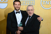 Actors Bradley Cooper (L) and Robert De Niro, winners of the Outstanding Performance by a Cast in a Motion Picture award for 'American Hustle,' pose in the press room during the 20th Annual Screen Actors Guild Awards at The Shrine Auditorium on January 18, 2014 in Los Angeles, California.