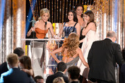 (L-R) Actors Julie Bowen, Ariel Winter, Sarah Hyland, Sofia Vergara and Ed O'Neill accept the Outstanding Performance by an Ensemble in a Comedy Series award for 'Modern Family' onstage during the 20th Annual Screen Actors Guild Awards at The Shrine Auditorium on January 18, 2014 in Los Angeles, California.