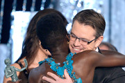 Actress Lupita Nyong'o (L) accepts the Outstanding Performance by a Female Actor in a Supporting Role award for '12 Years a Slave' from actor Matt Damon onstage during the 20th Annual Screen Actors Guild Awards at The Shrine Auditorium on January 18, 2014 in Los Angeles, California.