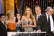 (L-R) Actors Rico Rodriguez, Julie Bowen, Ariel Winter, Sofia Vergara, Eric Stonestreet, and Ed O'Neill accept the Outstanding Performance by an Ensemble in a Comedy Series award for 'Modern Family' onstage during the 20th Annual Screen Actors Guild Awards at The Shrine Auditorium on January 18, 2014 in Los Angeles, California.