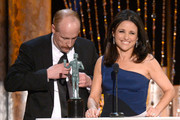 Actress Julia Louis-Dreyfus (R) accepts the Outstanding Performance by a Female Actor in a Comedy Series award for 'Veep' with actor Matt Walsh (L) onstage during the 20th Annual Screen Actors Guild Awards at The Shrine Auditorium on January 18, 2014 in Los Angeles, California.