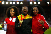(L-R) Silver medallist Laura Samuel of England, Gold medallist Kimberly Williams of Jamaica and bronze medallist Ayanna Alexander of Trinidad and Tobago pose on the podium during the medal ceremony for the Women's Triple Jump at Hampden Park during day six of the Glasgow 2014 Commonwealth Games on July 29, 2014 in Glasgow, United Kingdom.