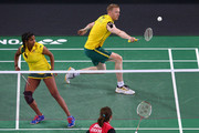 Renuga Veeran and Ross Smith of Australia play a shot during their Mixed Team Group Play match against Toby Ng and Alex Bruce of Canada at Emirates Arena during day two of the Glasgow 2014 Commonwealth Games on July 25, 2014 in Glasgow, United Kingdom.
