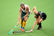 Tarryn Bright of South Africa is tackled by Krystal Forgesson of New Zealand in the Women's Bronze Medal Match at Glasgow National Hockey Centre during day ten of the Glasgow 2014 Commonwealth Games on August 2, 2014 in Glasgow, Scotland.