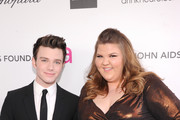 (L-R) Actors Chris Colfer and Ashley Fink attend the 21st Annual Elton John AIDS Foundation Academy Awards Viewing Party at Pacific Design Center on February 24, 2013 in West Hollywood, California.