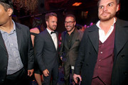 Actors Aaron Paul (L) and Jeremy Piven speak in the audience during the 21st Annual Huading Global Film Awards at The Theatre at Ace Hotel on December 15, 2016 in Los Angeles, California.
