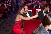 Actor Aaron Paul takes a selfie with a guest during the 21st Annual Huading Global Film Awards at The Theatre at Ace Hotel on December 15, 2016 in Los Angeles, California.