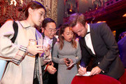 Actor Aaron Paul (R) signs autographs during the 21st Annual Huading Global Film Awards at The Theatre at Ace Hotel on December 15, 2016 in Los Angeles, California.